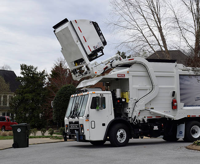 Emptying a Front-Dumping Refuse Container