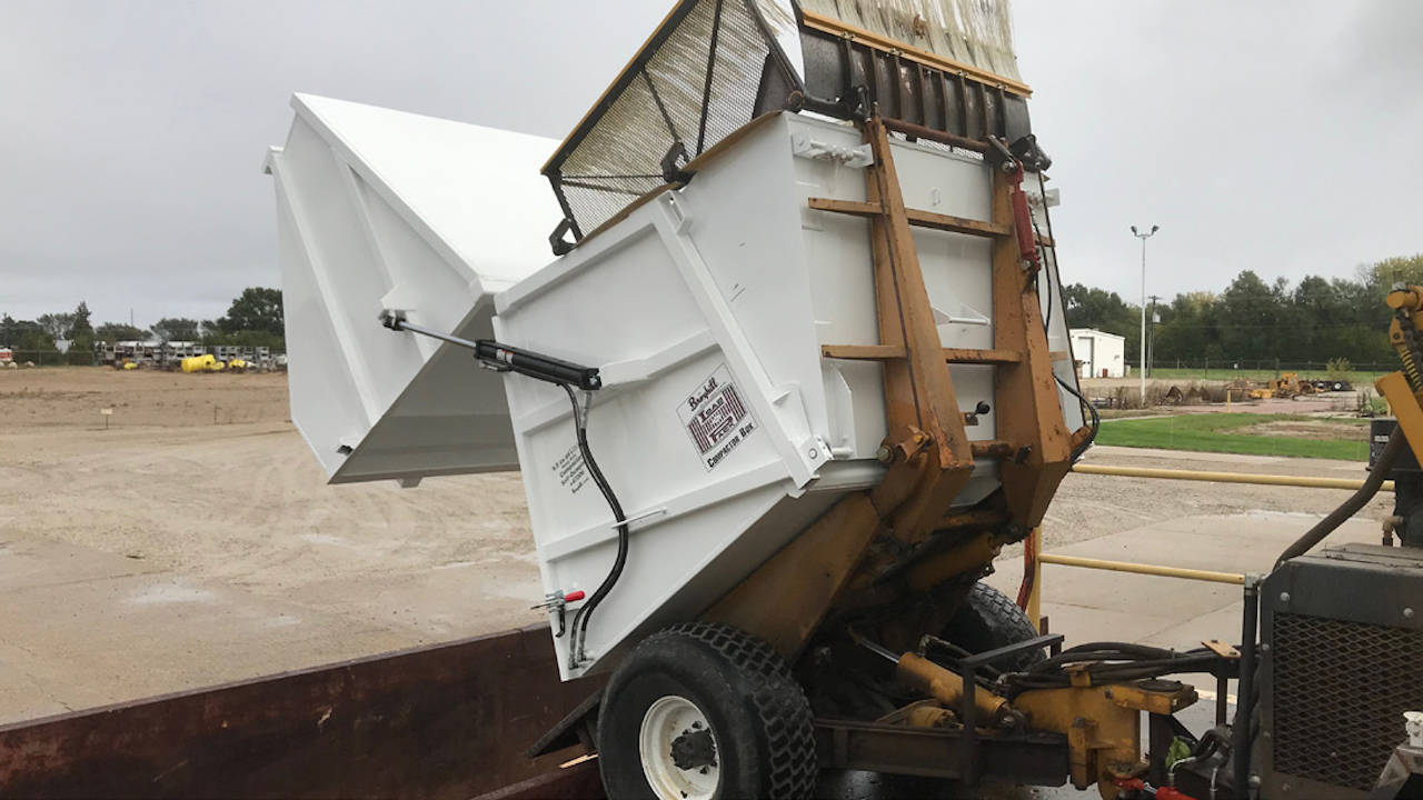 Emptying a Self-Dumping Refuse Container